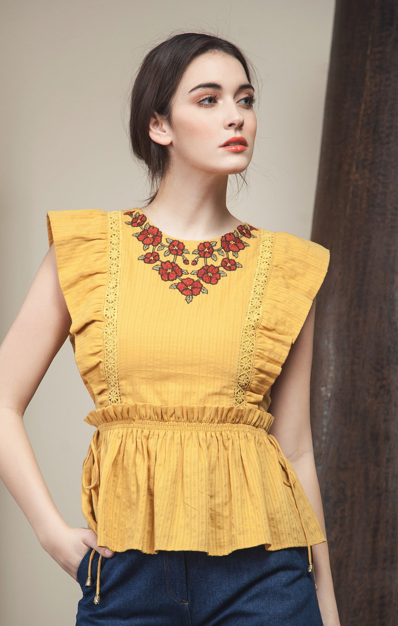 EMBROIDERED RUFFLE SLEEVELESS TOP