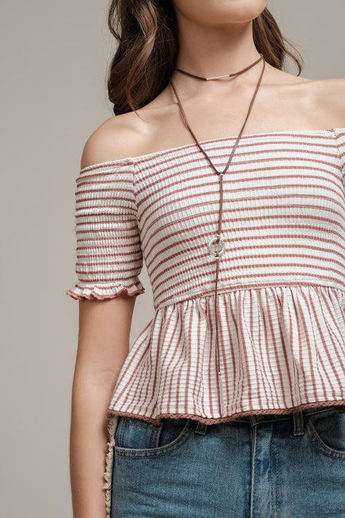 OFF THE SHOULDER TOP WITH FLARED WAIST