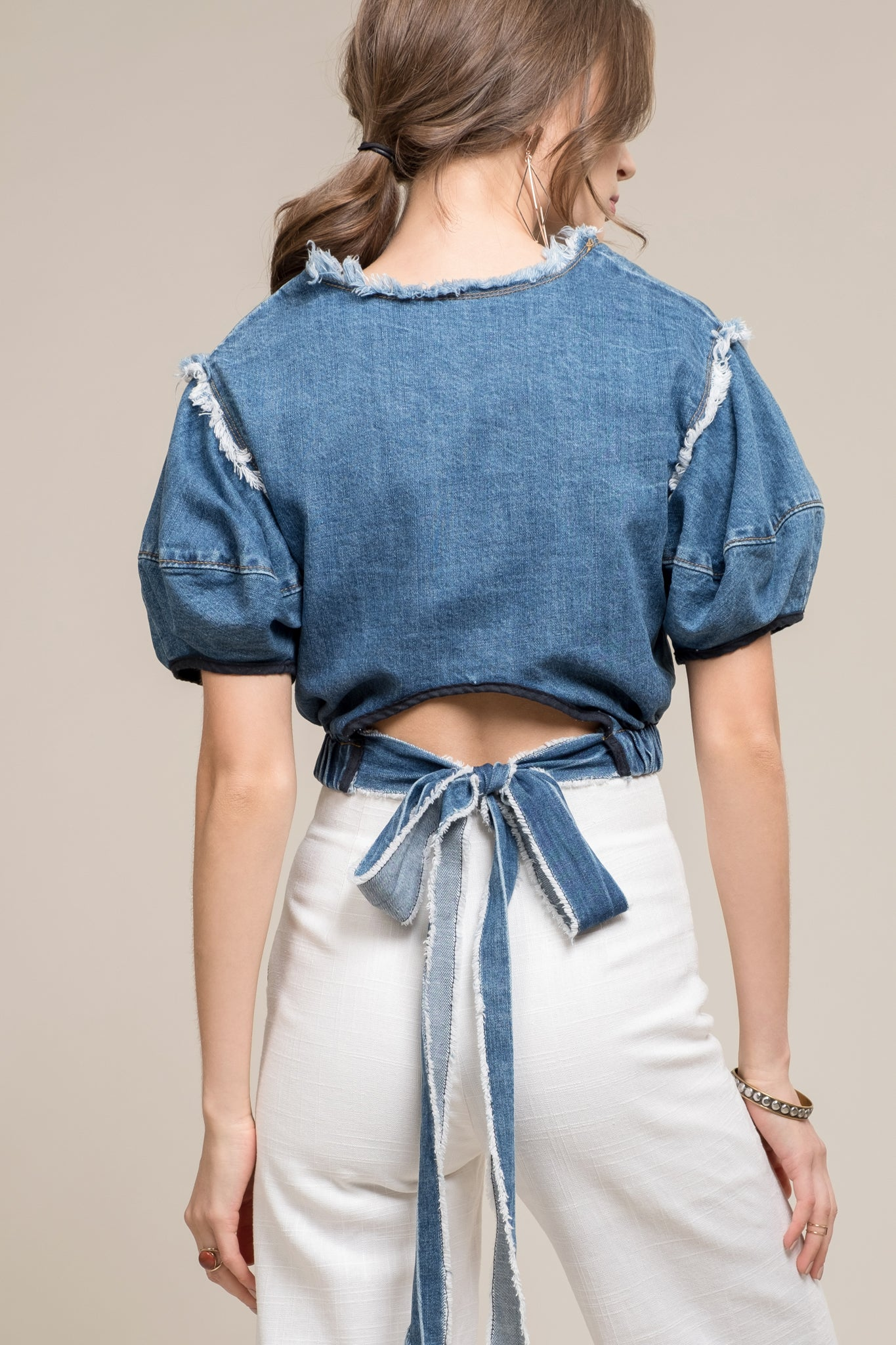 CINCHED DENIM CROP TOP WITH RAW DETAIL