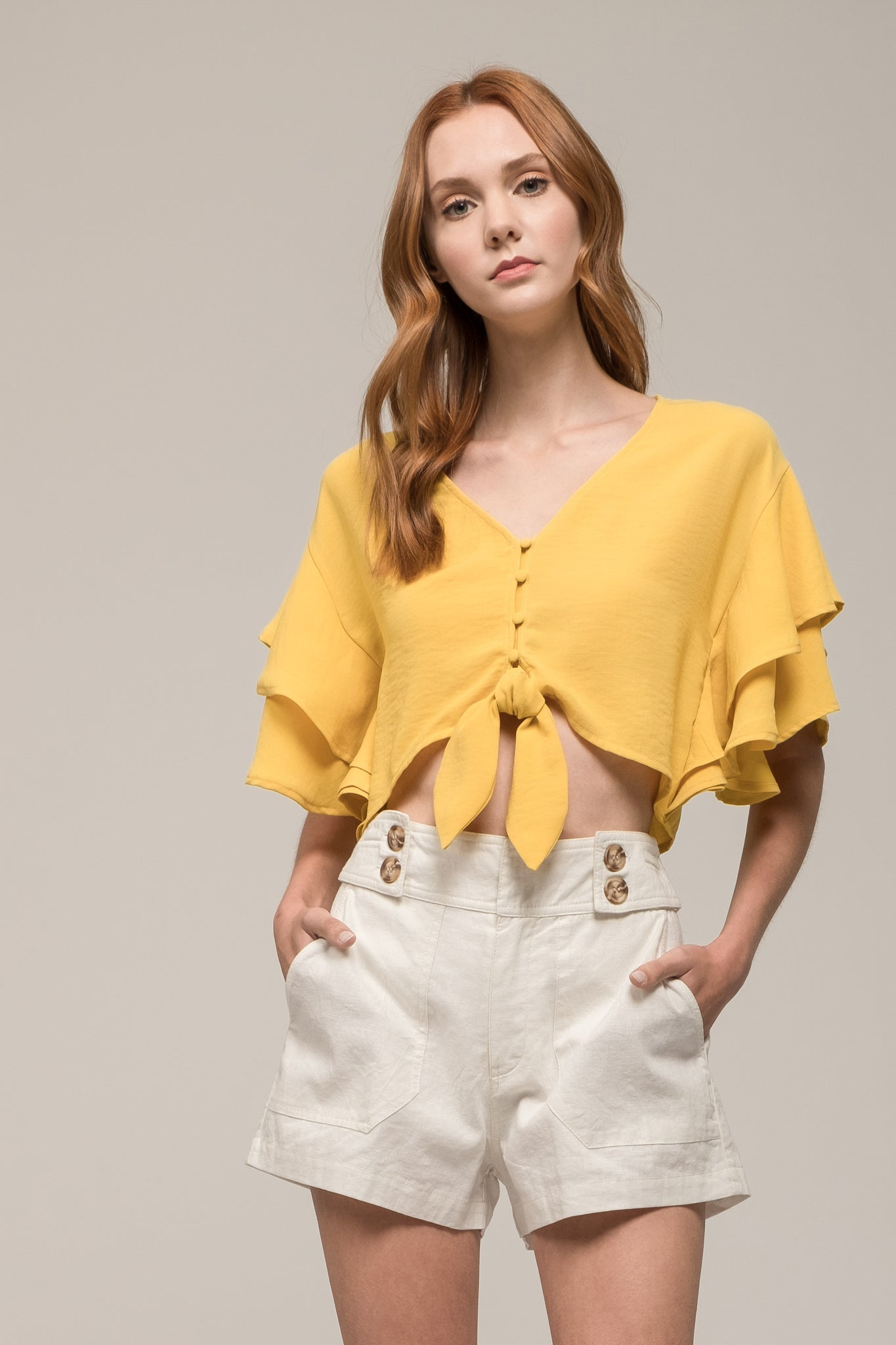 RUFFLED CROP TOP WITH FRONT TIE