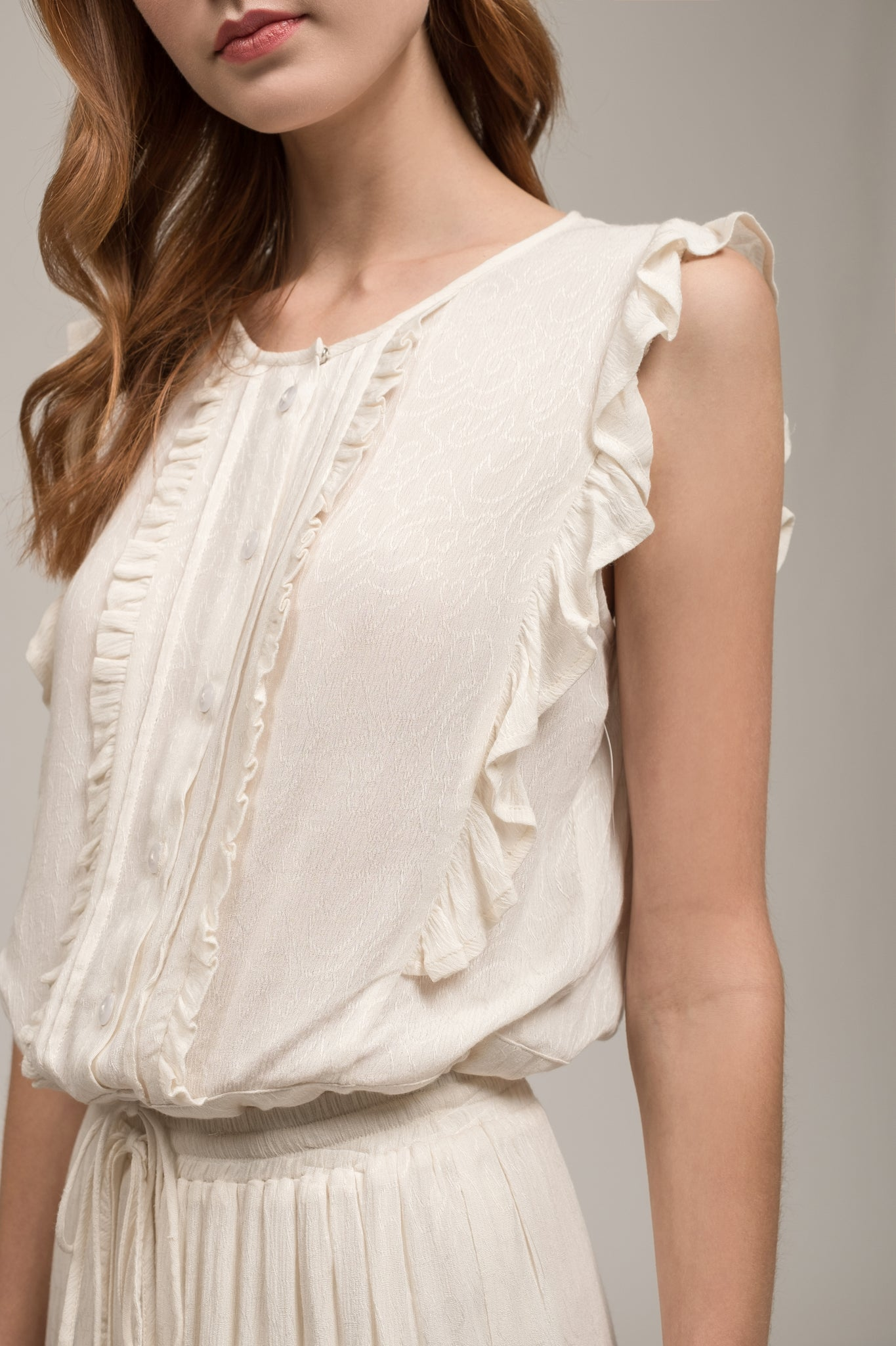 SLEEVELESS RUFFLE TIE WAIST TOP
