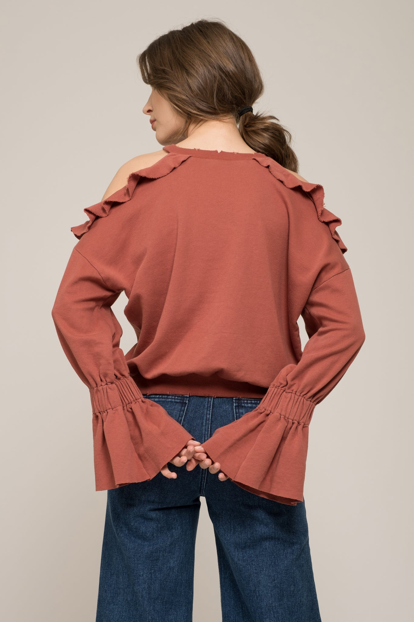 COLD SHOULDER RUFFLE TOP WITH DISTRESSED HEM