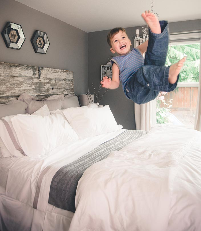 Kids Jumping on the Organic Cotton Bed