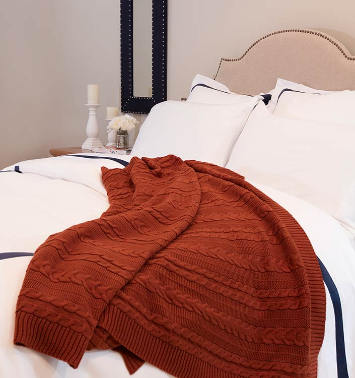 Pumpkin Organic Cotton Throw on Bed