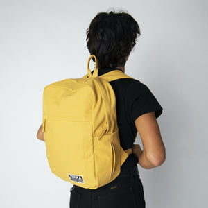 Male model wearing yellow backpacks for school