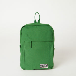 Front view of a Terra Thread green travel backpack