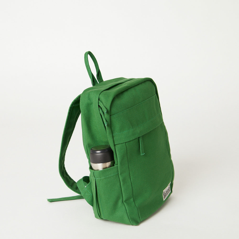 Load image into Gallery viewer, Side view of a Terra Thread green backpack women's