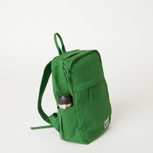 Side view of a Terra Thread green backpack women's