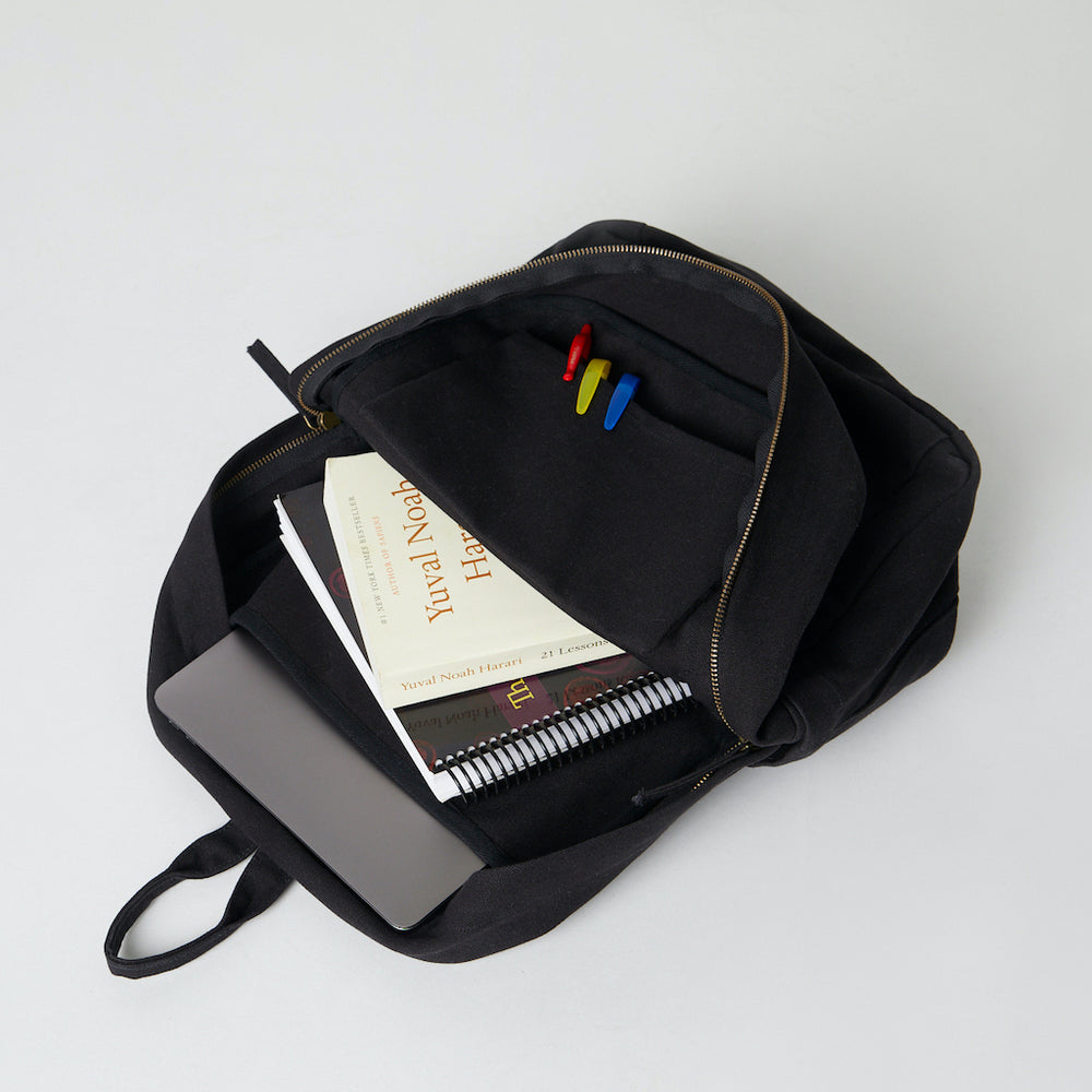 Load image into Gallery viewer, Inside of a Terra Thread black backpack for women