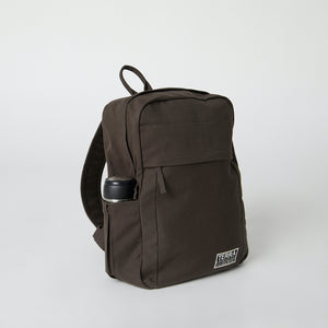 Side view of a brown Terra Thread organic cotton backpack