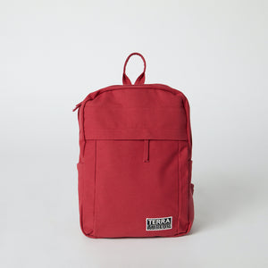 Front view of a red Terra Thread canvas backpack