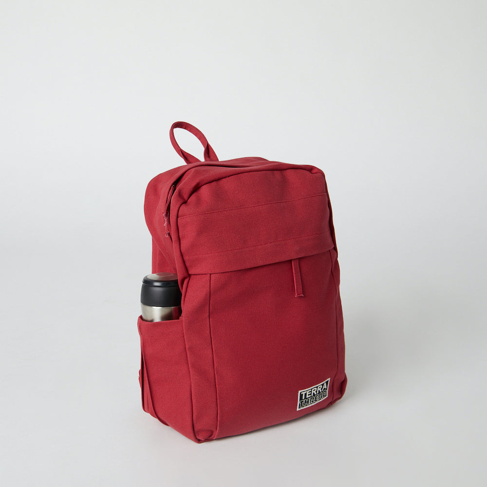 Load image into Gallery viewer, Side view of a Terra Thread organic cotton backpack