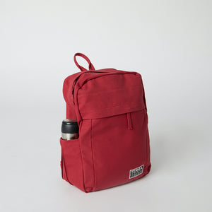 Side view of a Terra Thread organic cotton backpack