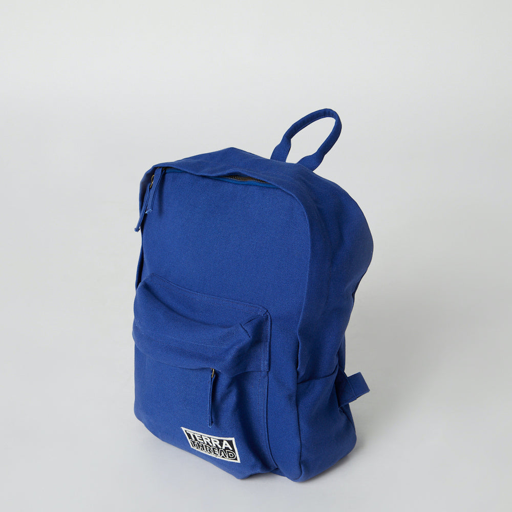 side view of blue color organic cotton canvas backpack