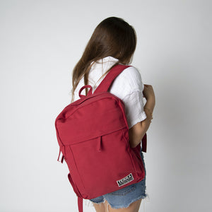 A female wearing a red backpack women's