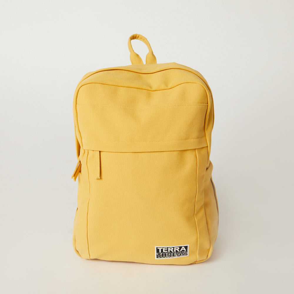 Front view of a Terra Thread yellow backpack for school