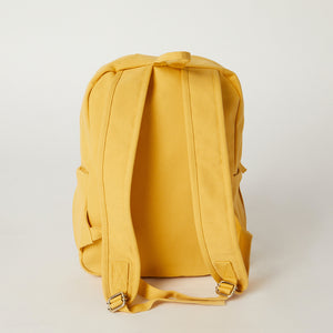 Back view of a yellow travel backpack from Terra Thread
