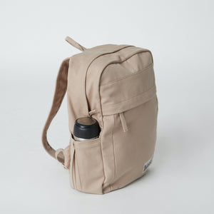 Load image into Gallery viewer, Side view of a Terra Thread Fair Trade backpack