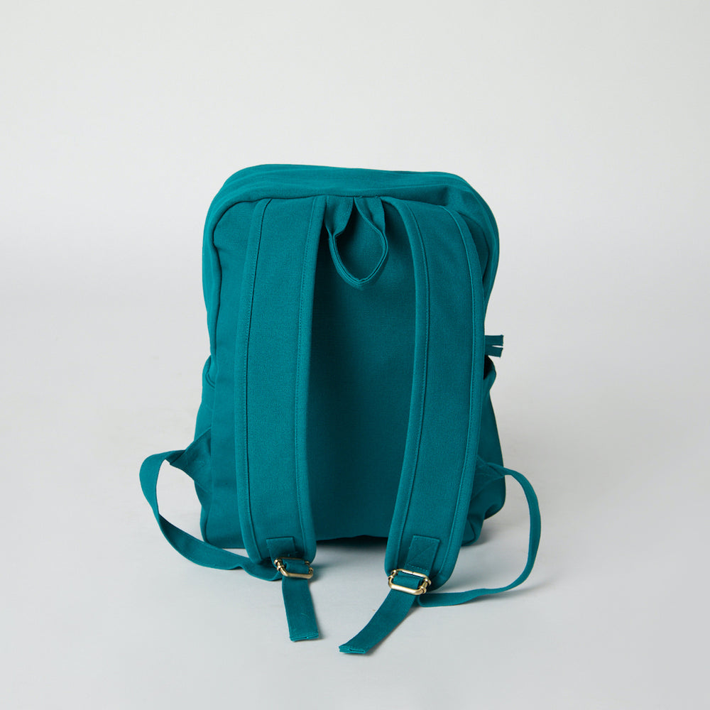 Load image into Gallery viewer, Back view of a teal Terra Thread vegan backpack