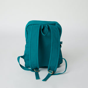 Back view of a teal Terra Thread vegan backpack