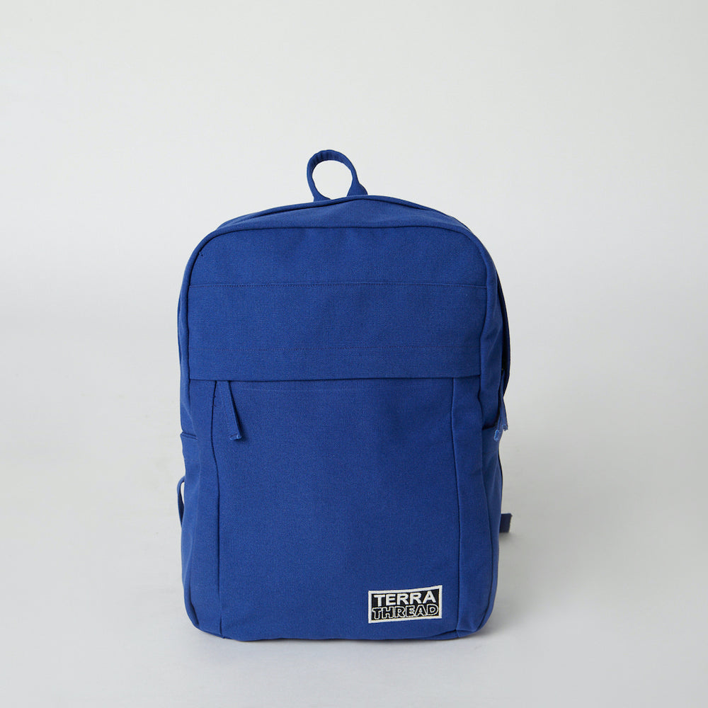 Front view of a Terra Thread blue cotton canvas backpack