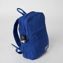 Load image into Gallery viewer, Side view of a blue Terra Thread 100 cotton backpack