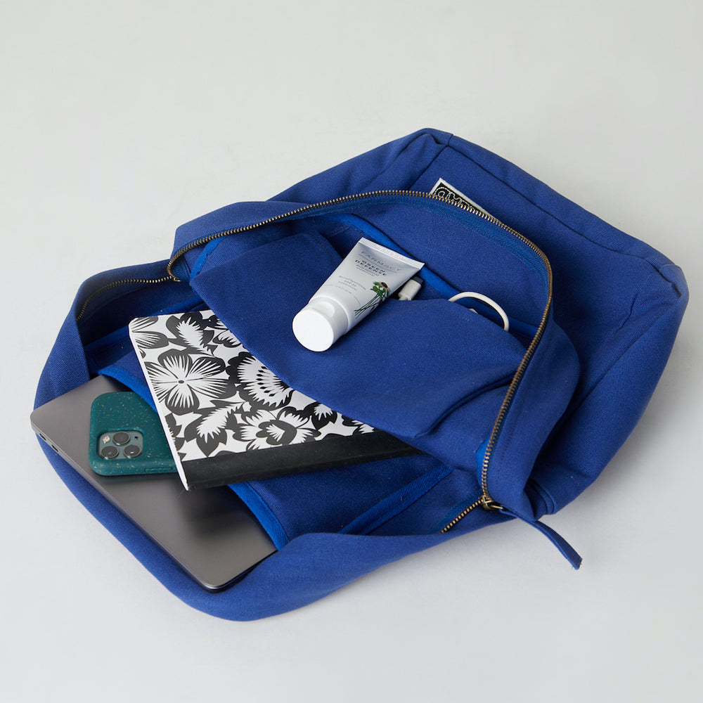 Inside of a blue Terra Thread cotton square backpack