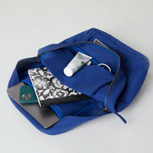 Load image into Gallery viewer, Inside of a blue Terra Thread cotton square backpack