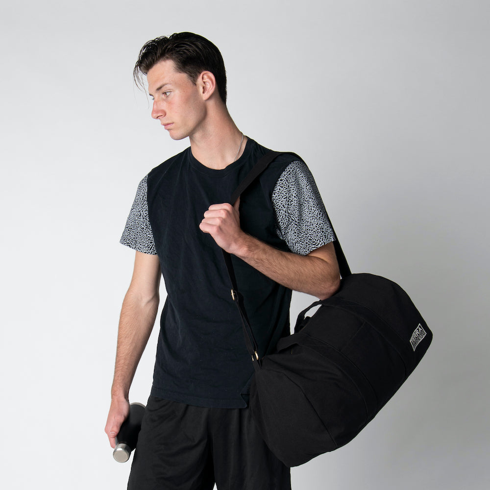 Load image into Gallery viewer, sustainable gym bags with male model- black color