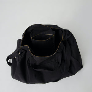 Inside view of a black canvas travel duffle bag