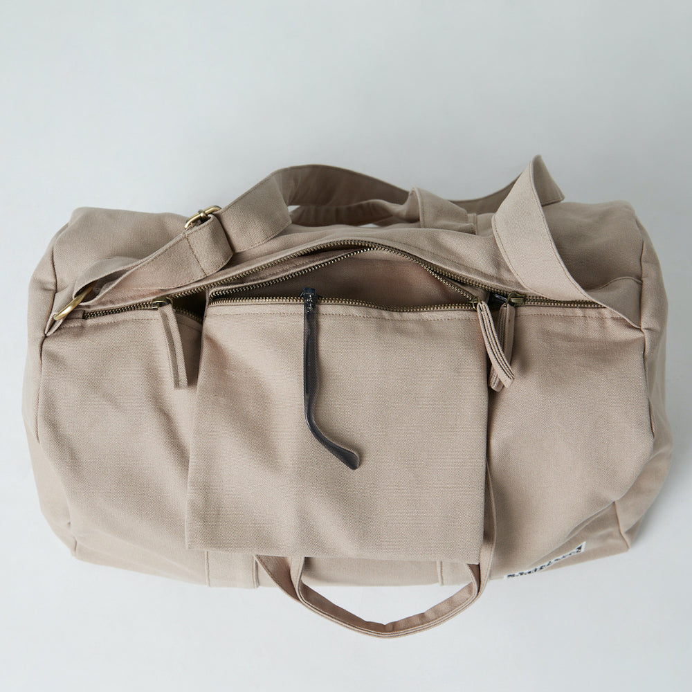 best organic gym bag with inside pocket. Beige color