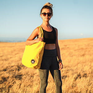 Model Carrying Yellow Terra Thread Tote Bag