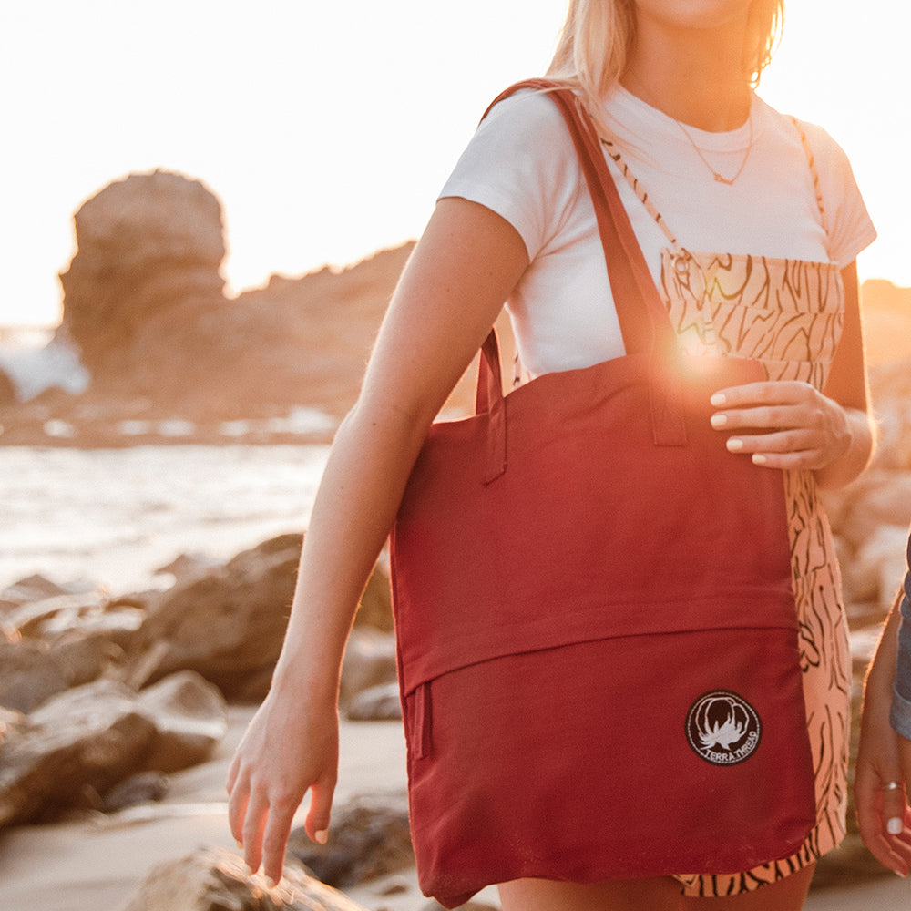 Model Carrying Terra Thread Tote Bag in Red Color at The beach