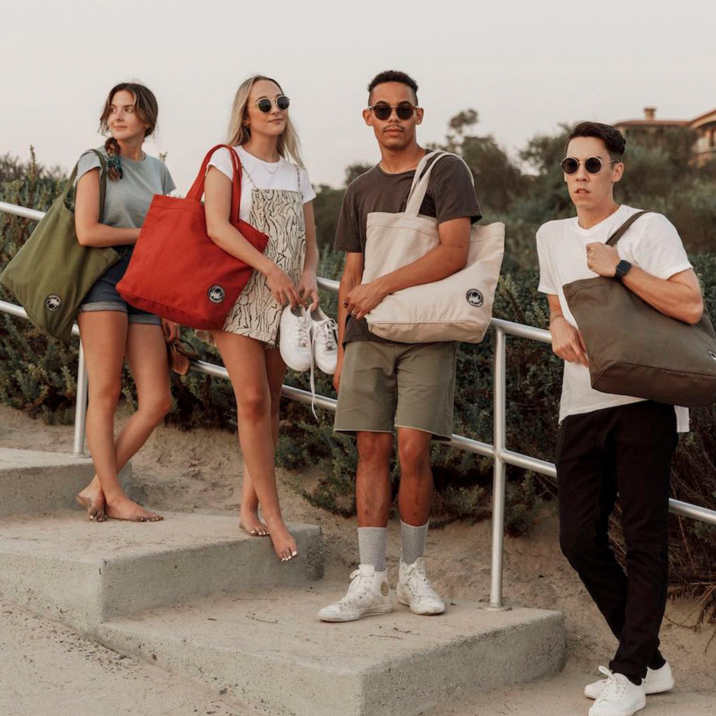 Models carrying Terra Thread Tote Bags