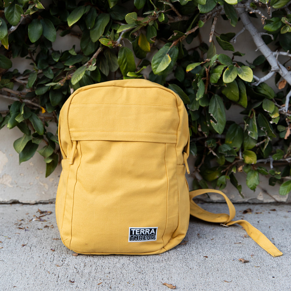 Load image into Gallery viewer, Mustard colored yellow backpack made with organic cotton canvas