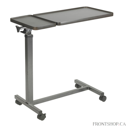 The Multi-Purpose Tilt-Top Split Overbed Table from Drive Medical gives you two stable, independent surfaces for eating, working, or entertainment. The height of the attractive wood-grain tabletops is infinitely adjustable and the larger surface can be angled to place it at the ideal position for you. The smaller surface always remains flat, perfect for keeping food, drink, glasses, remote controls, or other items secure. This Multi-Purpose Tilt-Top Split Overbed Table can also be used as a mobile workstati