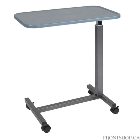 The Overbed Table with Plastic Top from Drive Medical gives you a stable surface for eating, working or entertainment. The height of the durable tabletop is infinitely adjustable and can be angled to place it in the ideal position for you. Plus, the plastic top will never crack or peel like laminated table tops. It even has convenient areas for placing drinks and a lip around the edge to contain spills. And the Overbed Table's caster wheels make it easy to maneuver.