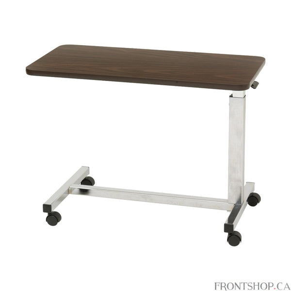"With a 3.25"" frame-to-floor clearance, this overbed table by Drive Medical was designed specifically for use with low beds. A spring-loaded lift mechanism provides infinite height adjustments from 19.75"" to 28.75"". The roomy 15"" x 30"" high pressure laminate top with T-molding still provides plenty of surface area and has a weight capacity of 50 pounds. Twin 1.5"" swivel casters allow for easy maneuverability."