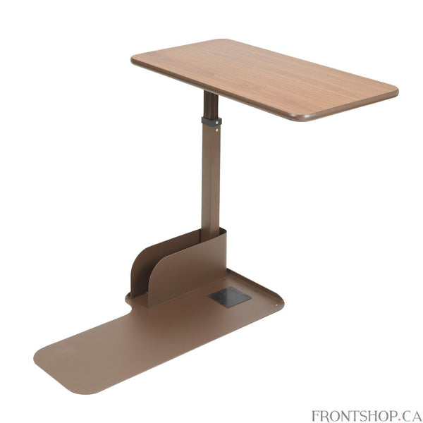 This deluxe left side overbed table by Drive Medical serves many purposes. It can be used for eating, writing, crafts, working on the computer, reading, games and much, much more. The product was designed for use with a lift chair, standard recliner or couch. The table comes available in right or left positioning with 180 degree rotation, allowing a chair to be placed near any wall. The attractive, teak wood grain laminate finish top is easy to clean and scratch resistant. It pivots 360 degrees at the touch