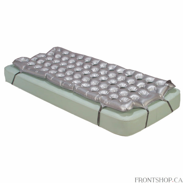 The Air Mattress Overlay Support Surface by Drive Medical's unique construction allows for efficient air flow throughout the mattress for use in the treatment and prevention of pressure ulcers. The air flow holes in the mattress, reduce heat and fluid build up, ensuring that the affected areas remain well ventilated and dry for proper healing. The adjustable bed straps prevent the mattress from moving and ensuring user safety and comfort.