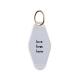 "He Said She Said ""Love Lives Here"" Keytag"