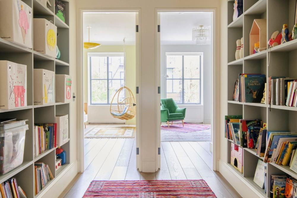 Jack and Jill kids' rooms are fronted by a library/play space. The Canvas Storage Boxes on the shelves are from Kaikai & Ash.
