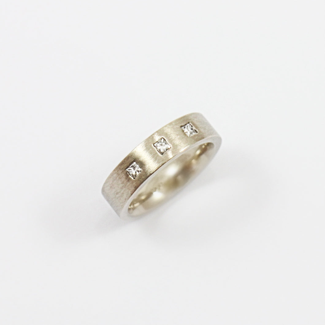 White Gold Flat Band with three Diamonds
