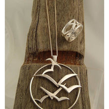 Load image into Gallery viewer, Handmade Silver Sea Bird Circle Pendant on wood by Charlotte Cornelius