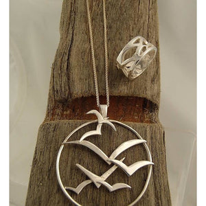 Handmade Silver Sea Bird Circle Pendant on wood by Charlotte Cornelius