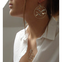 Load image into Gallery viewer, Silver Bird Flock Circle Earrings Model Image by Charlotte Cornelius