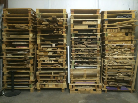 stacks of pallets with small remnants of oak, mesquite and plywood in-between