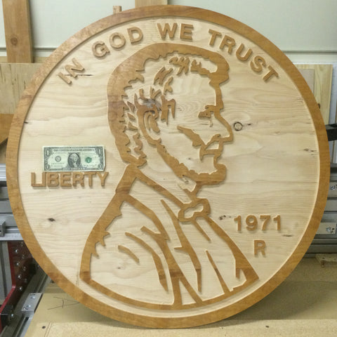 oversized penny cut from plywood