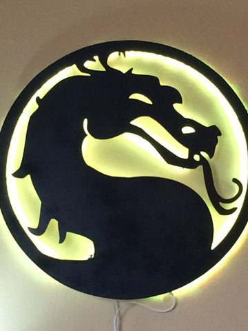 mortal kombat silhouette with backlit lime green glow