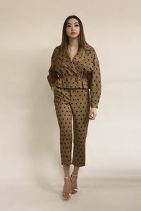 This brown with black polka dots tilored ankle pants are a go-to wardrobe addition. High rise with side pockets for on the go women. Tapered leg and relaxed fit. Comes with a matching belt to give it a final touch. Wear it with its matching Audrey Polka Dot Jacket to achieve that fall parisian look.